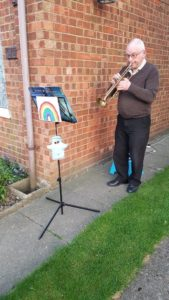 Phil, Appropriate Adult volunteer playing his trumpet during clap for our carers in lockdown